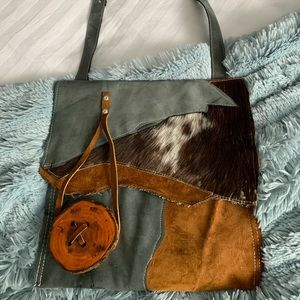 Uniquely crafted leather bag, recycled materials.